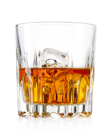 Glass of whiskey and ice isolated on white background Reklamní fotografie