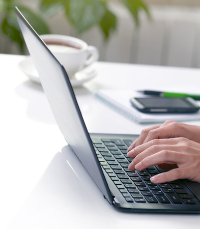 Woman hands typing on laptop photo