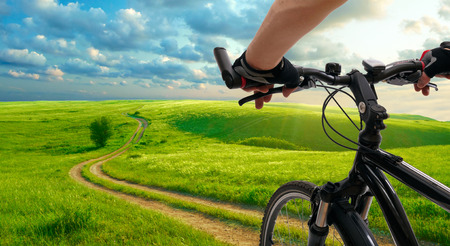 Man with bicycle riding country road Stockfoto