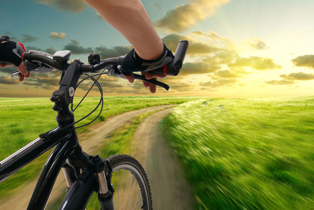 bike riding: Man with bicycle riding country road Stock Photo