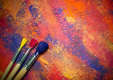 grange: Paintbrushes on abstract grange background