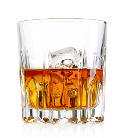 Glass of whiskey and ice isolated on white background Imagens