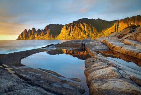 breen: Peaks of the Okshornan mountain in sunset lights. Senja island, Norway
