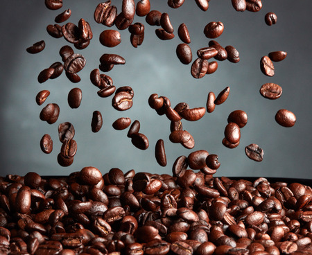 coffee beans: Flying coffee beans over dark background Kho ảnh