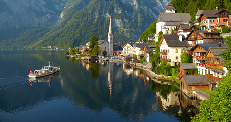 austrian village: Hallstatt village and alpine lake in morning lights. Austrian Alps Stock Photo