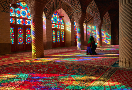 shiraz: SHIRAZ, IRAN - March 01, 2016: Young Muslim woman praying in Nasir Al-Mulk Mosque (Pink Mosque), Iran, Shiraz Editorial