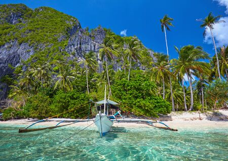 nido: Traditional filippino boat at El Nido bay. Palawan island, Philippines Stock Photo