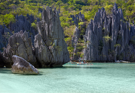 foursquare: Landscape with filippino boat, rocks and blue bay. El Nido, Palawan island, Philippines
