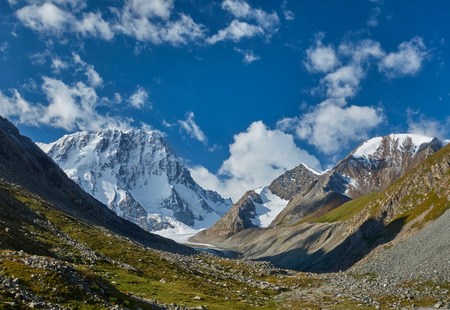 kyrgyzstan: Tian Shan mountains. Kyrgyzstan, Central Asia. Landscape with blue sky and snowy mountains