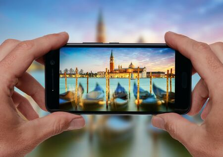 saint mark's: Hands taking picture of Venice, Italy in sunset lights with smartphone camera. Travel concept.