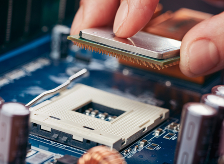 microprocessor: Plug in CPU microprocessor to motherboard socket. Technological background