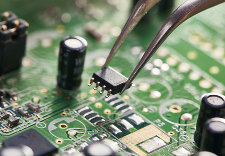 Assembling a circuit board. Technological background Stock Photo
