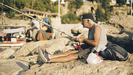 Antalya, Turkey - August 18, 2017: Fisherman on Old Marina Editorial