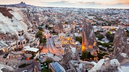 Goreme village in Cappadocia at sunset in Turkey Imagens