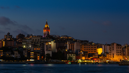 Istanbul cityscape with Galata Tower and floating tourist boats in Bosphorus Stock Photo