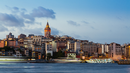 Istanbul cityscape with Galata Tower and floating tourist boats in Bosphorus 스톡 콘텐츠