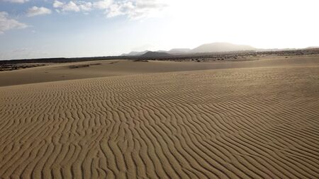 corralejo: Sand pattern zigzags with mountains, Park Natural, Corralejo, Fuerteventura, Canary islands