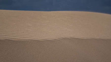 desert sand: Ridge Pattern in the sand Park Natural with cloudy sky in Corralejo, Fuerteventura, Canary islands,Spain