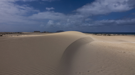 corralejo: Playing with light on sand under a blue sky, Park Natural, Corralejo, Fuerteventura, Canary islands,Spain