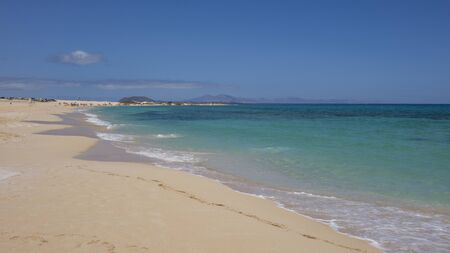breaking waves: The beach with breaking waves on the Natural park,Corralejo,Canary-islands,Spain