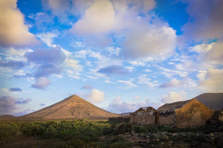 oliva: colorful colourful sky over mountainns in La Oliva Fuerteventura the Canary-Islands Spain Stock Photo