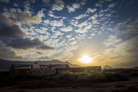 oliva: Dramatic sunset in La Oliva in Fuerteventura the Canary-Islands in Spain Stock Photo
