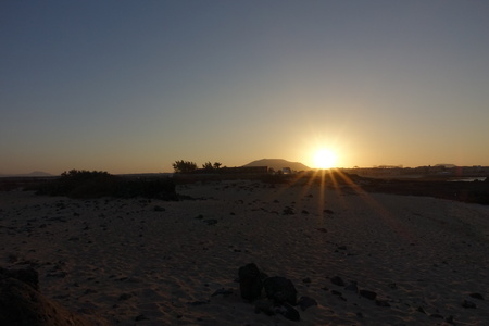 Sunset behind the mountains over the sand dunes in the Natural Park in Fuerteventura, Canary Islands, Spain. Stock Photo