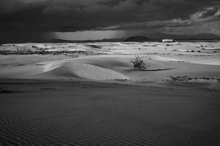 Dramatic beautiful interesting sky in evening light over the dunes in the Natural park of Corralejo, Fuerteventura, Las Palmas, Canary islands, Spain.