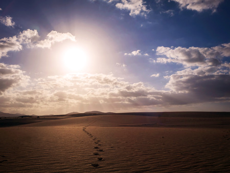 Low sun with dramatic light in  Park Natural, Corralejo, Fuerteventura, Canary islands,Spain