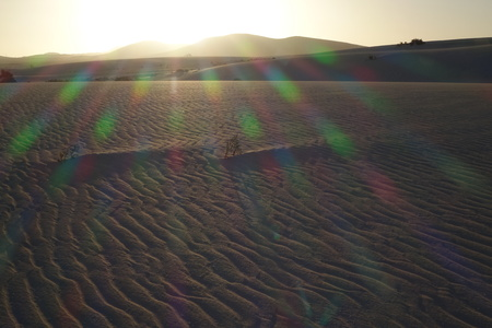 Colour spectrum created by low sun giving a atmospheric effect over the sand in the natural park in Corralejo,Fuerteventura, Canary Islands Spain