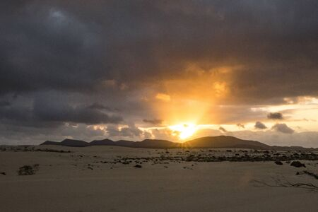 Beautiful Colourful Sun setting over the mountains In the Natural Park Corralejo Fuerteventura Canary Islands Spain