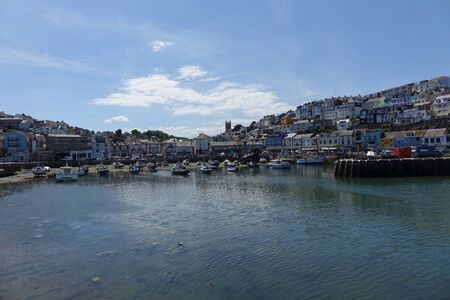 Beautiful Brixham harbour landscape in early afternoon in the middle of a hot bright summer