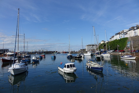 Boats in Brixham harbour in bright sunlight