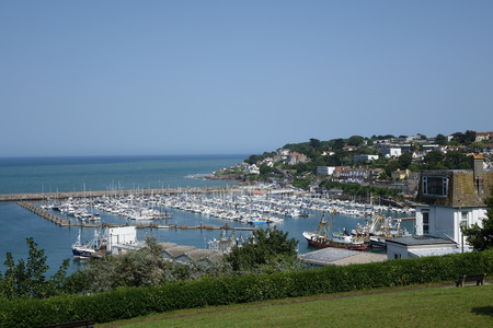 Beautiful seascape in midday sun of Brixham in Devon overlooking the harbour