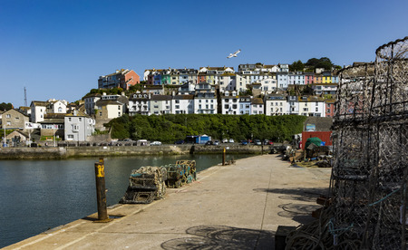 Beautiful Brixham harbour landscape in the middle of a hot bright summer in early afternoon
