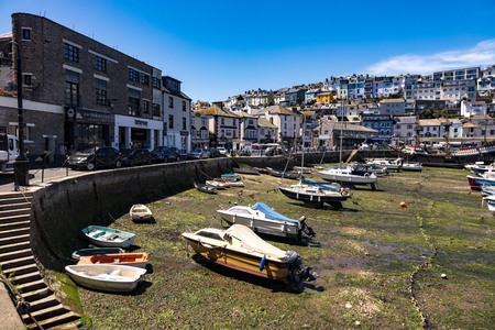 Beautiful Brixham landscape in the middle of a hot bright summer in early afternoon with an empty harbour in the foreground Editorial