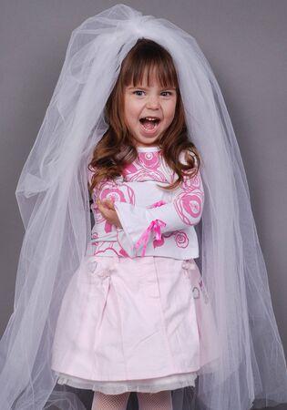 pretty little girl in white veil