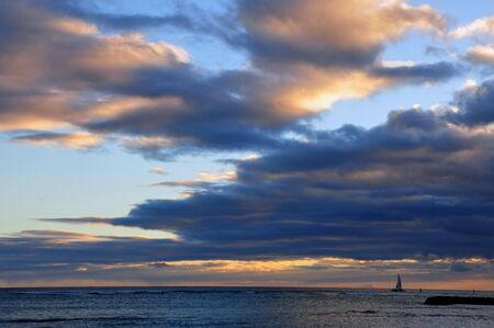 Sailboat in the ocean and sunset photo