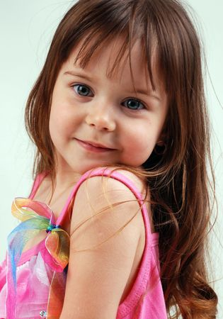 pretty little girl in pink dress Stock Photo - 8090391