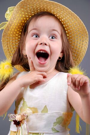 smiling little girl in a straw hat