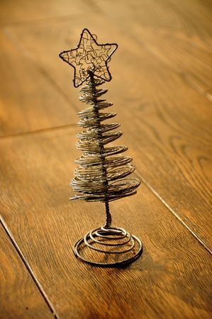 Silver christmas tree on a wooden floor photo