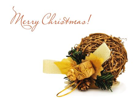Golden Christmas ball made of willow on the white Stock Photo