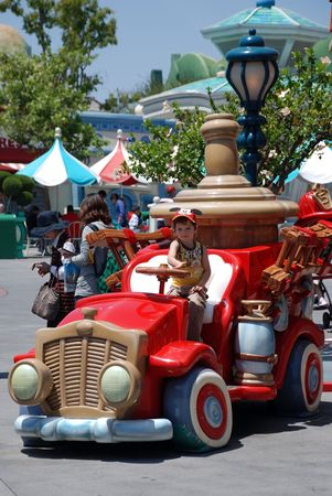 boy in the toy car in mickeys toontown in disneyland california