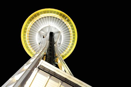 View of the Space Needle from the base looking up to the top at night, Seattle, USA