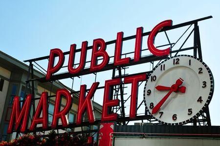 famous place: Pike Place Market sign with big clock in the evening, Seattle, USA