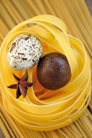 tagliatelle pasta and quail eggs  photo