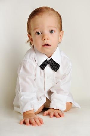 cute little boy in a white shirt Stock Photo