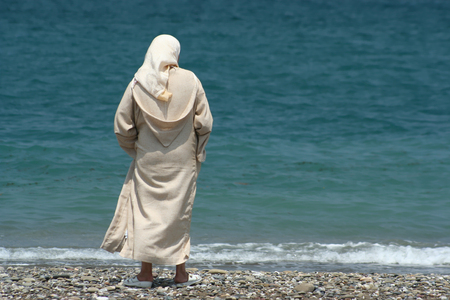 arab woman contemplating the sea