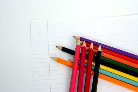 university word: paper with lines and several colored pencils isolated in white background
