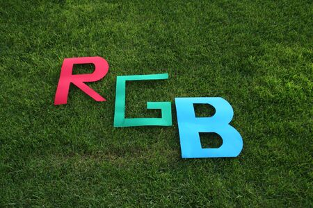 rgb: RGB letters in the green grass